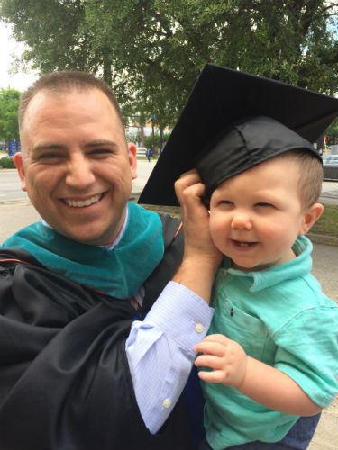 Andrew Malkowski at graduation with his son Gabriel